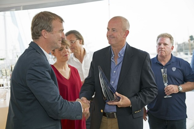 Captain of 'Home'receives the Baccarat- SuperYachtWord award from editor Hugo Andreae.jpg
